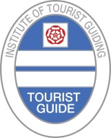 Blue badge of tourist guide